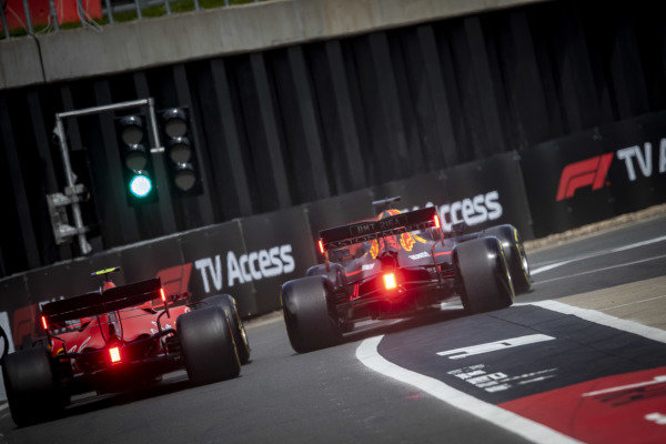 Max Verstappen, Red Bull Racing RB15 and Charles Leclerc, Ferrari SF90 wheel to wheel in the pit lane