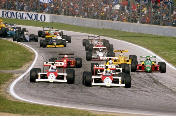 Imola, Italy.21-23 April 1989.Ayrton Senna leads teammate Alain Prost, (both McLaren MP4/5 Honda's) at the start. Ref-89 SM 01.World Copyright - LAT Photographic