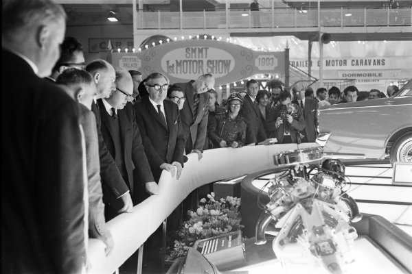Labour deputy Prime Minister George Brown views the Ford Corsair's V4 engine.