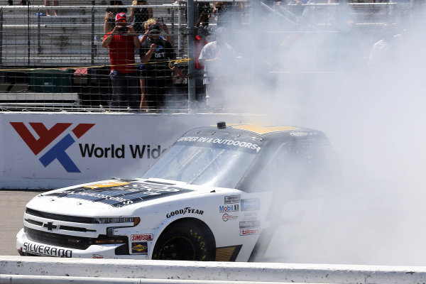 #2: Sheldon Creed, GMS Racing, Chevrolet Silverado Chevy Accessories celebrates his win with a burnout