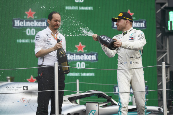 Valtteri Bottas, Mercedes AMG F1, 3rd position, sprays Champagne on the podium