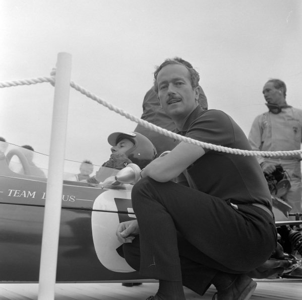 Colin Chapman with race winner Jim Clark on the victory lap.