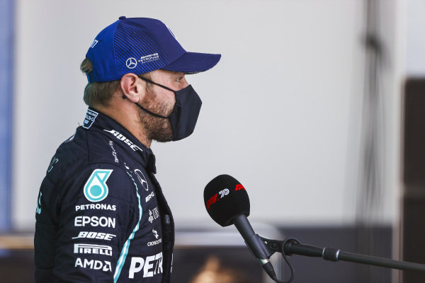 Valtteri Bottas, Mercedes-AMG Petronas F1, talks to the press after getting pole posistion