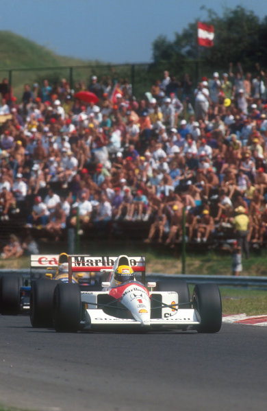 1991 Hungarian Grand Prix.Hungaroring, Budapest, Hungary.9-11 August 1991.Ayrton Senna (McLaren MP4/6 Honda) closely followed by Riccardo Patrese (Williams FW14 Renault). They finished in 1st and 3rd positions respectively.Ref-91 HUN 07.World Copyright - LAT Photographic