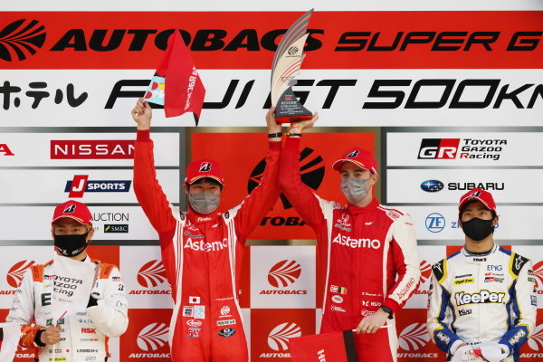GT500 Winners Koudai Tsukakoshi & Bertrand Baguette, Astemo Honda NSX-GT, celebrate on the podium. Alongside are Kazuya Oshima & Kenta Yamashita, ENEOS X PRIME Toyota GR Supra, 2nd in GT500, and Ryo Hirakawa & Sena Sakaguchi, KeePer TOM'S Toyota GR Supra, 3rd in GT500