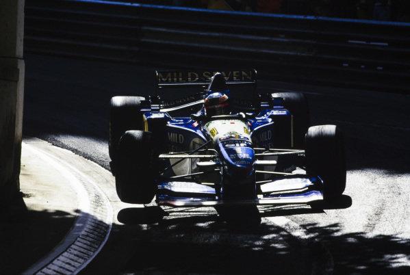 Michael Schumacher, Benetton B195 Renault, gets a wheel off the ground.