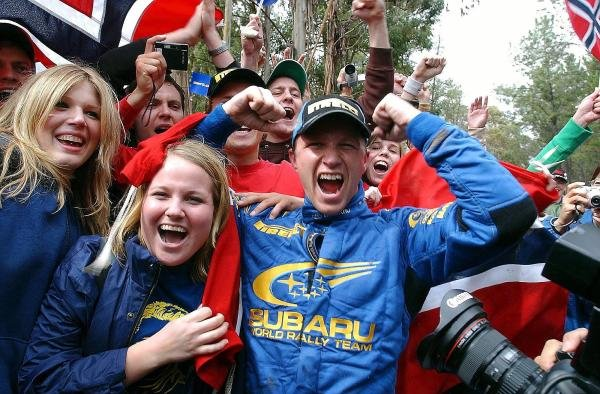Rally winner Petter Solberg (NOR) Subaru celebrates victory with Norwegian fans at the end of the final stage.World Rally Championship, Rd10, Telstra Rally Australia, Day Three, Perth, Australia, 7 September 2003.DIGITAL IMAGE