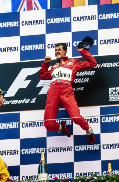 Michael Schumacher, 1st position, jumps in celebration on the podium.