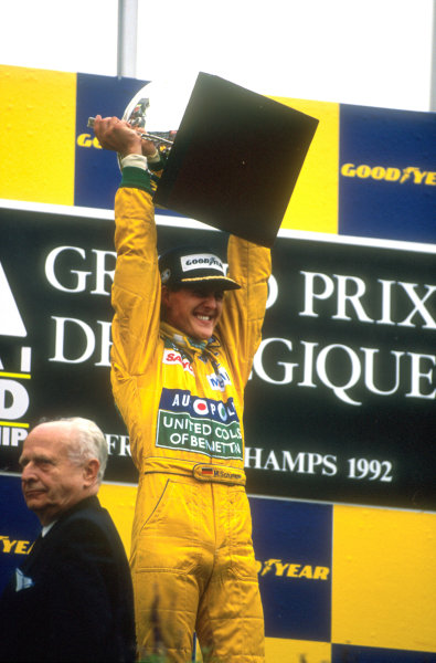 1992 Belgian Grand Prix.Spa-Francorchamps, Belgium.28-30 August 1992.Michael Schumacher (Benetton Ford) celebrates 1st position and his maiden Grand Prix win on the podium.World Copyright: LAT Photographic. Ref: 92BEL06.