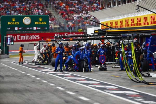 The Toro Rosso pit crew get ready for a stop.