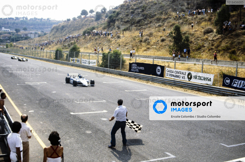 Jonathan Palmer, Ralt RH6/83H Mugen Honda, crosses the finish line and takes the chequered flag.