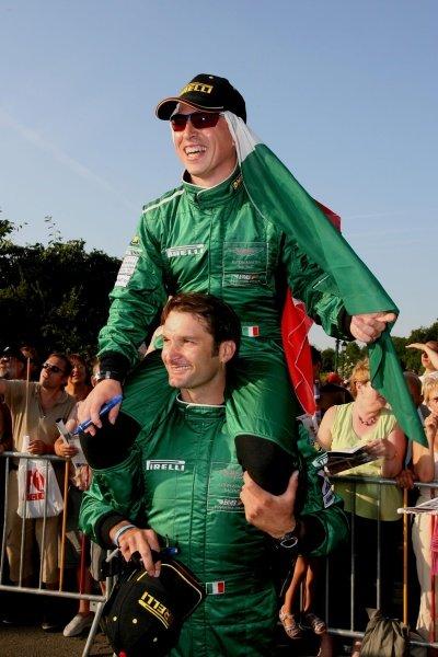 Christian Pescatori (ITA) BMS Scuderia Italia reaches new heights on the shoulders of Fabio Babini (ITA) during the drivers parade! Le Mans 24hr 14-18 June 2006, Le Mans France. DIGITAL IMAGE