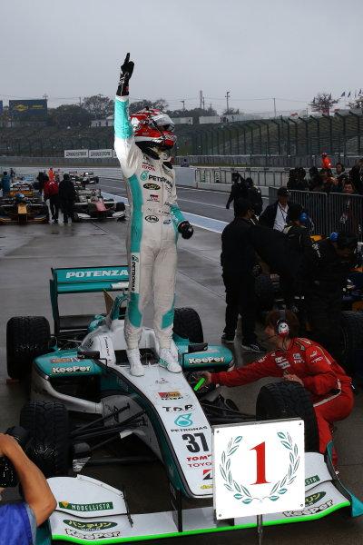 2014 Super Formula Series. Suzuka, Japan. 9th - 10th November 2014. Rd 7. Race 2 - Winner Kazuki Nakajima ( #37 TEAM TOM'S SF14 ) parc ferme, portrait World Copyright: Yasushi Ishihara / LAT Photographic. Ref:  2014_SF_Rd7_018.JPG