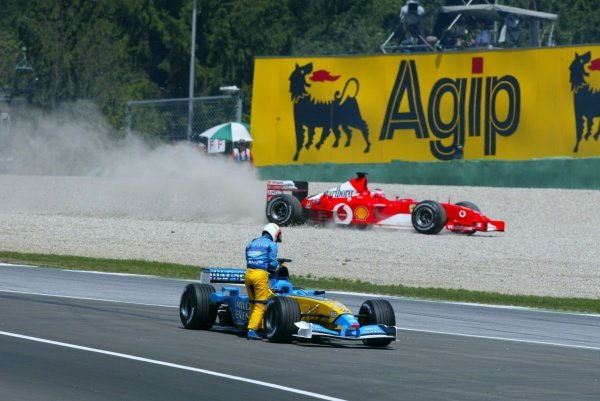 Jarno Trulli (ITA) Renault R202 blew his engine, stopping the session, and pole sitter Rubens Barrichello (BRA) Ferrari F2002 went off on his oil. Austrian Grand Prix, A1-Ring, 11 May 2002. DIGITAL IMAGE