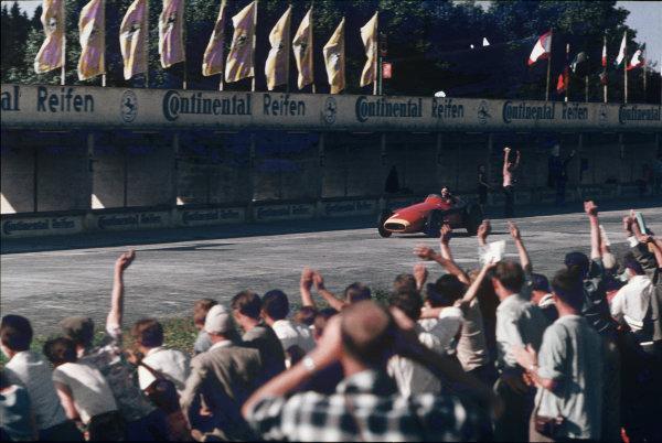 Nurburgring, Germany. 2-4 August 1957. Juan Manuel Fangio, Maserati 250F, 1st position. Ref: 57GER21. World Copyright - Tony Smythe/LAT Photographic