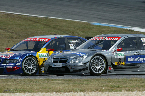 2004 DTM ChampionshipEstoril, Portugal. 1st - 2nd May 2004.Race winner Christijan Albers (HWA Mercedes C-Class) battles with Mattias Ekstrom (Abt Sportsline Audi A4) for the lead.World Copyright: Andre Irlmeir/LAT Photographicref: Digital Image Only