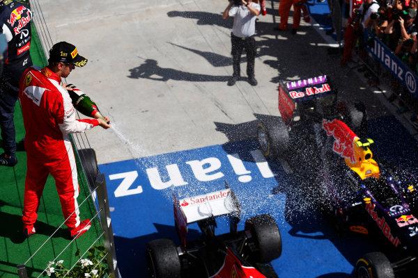 Hungaroring, Budapest, Hungary. Sunday 26 July 2015. Sebastian Vettel, Ferrari, 1st Position, sprays the victory Champagne. World Copyright: Alastair Staley/LAT Photographic ref: Digital Image _79P0946