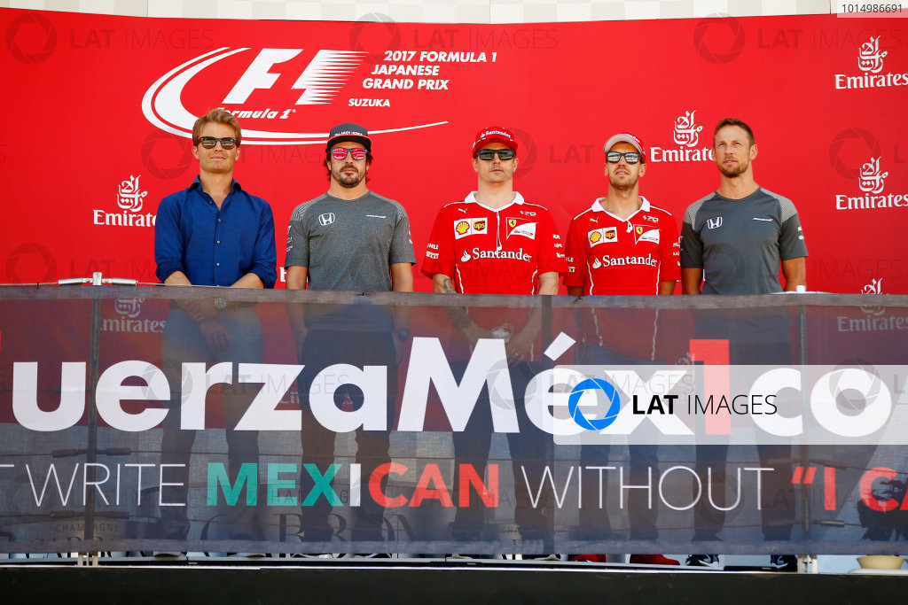 Suzuka Circuit, Japan. Sunday 08 October 2017. Nico Rosberg, Fernando Alonso, McLaren, Kimi Raikkonen, Ferrari, Sebastian Vettel, Ferrari, and Jenson Button take part in an event in support of Mexico on the podium. World Copyright: Andy Hone/LAT Images  ref: Digital Image _ONY8412