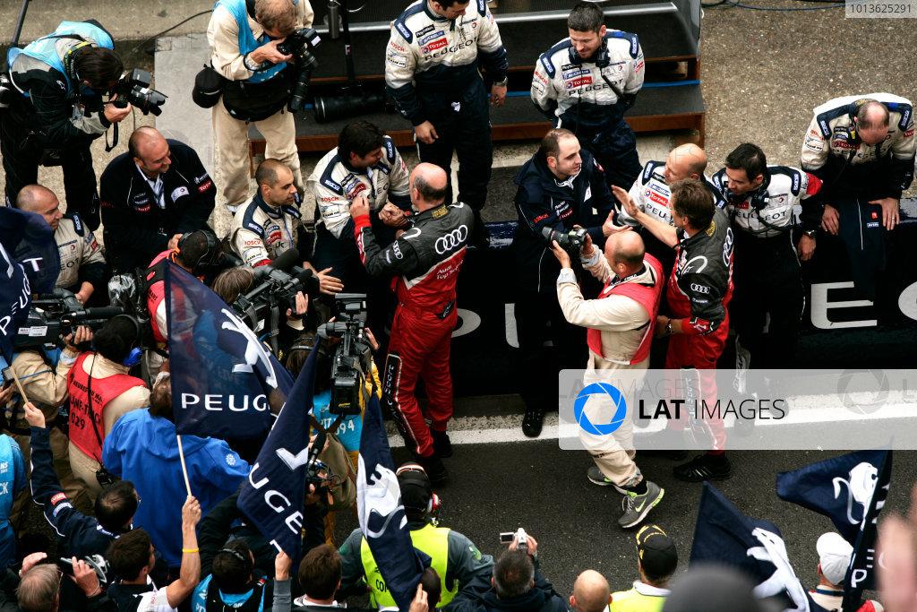 Circuit de La Sarthe, Le Mans, France. 5th - 12th June 2011.Marcel Fassler / Andre Lotterer / Benoit Treluyer, Audi Sport Team Wolfgang Ullrich, Team Principal, Audi Sport celebrates with the Peugeot Sport Total team. Portrait. Atmosphere. Photo: Drew Gibson/LAT Photographic.  ref: Digital Image _Y2Z6615