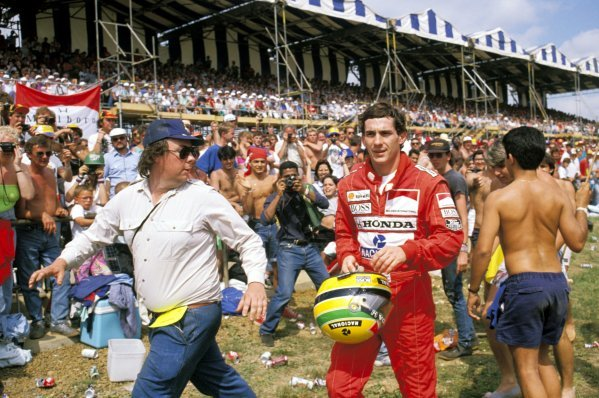 Ayrton Senna (BRA) McLaren walks past the crowd of spectators after spinning out of the race on lap 12. British Grand Prix, Rd 8, Silverstone, England, 16 July 1989.