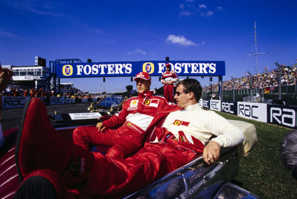Michael Schumacher and Eddie Irvine ready for the drivers' parade.