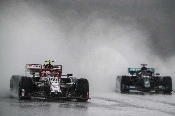 Antonio Giovinazzi, Alfa Romeo Racing C39, leads Lewis Hamilton, Mercedes F1 W11 EQ Performance