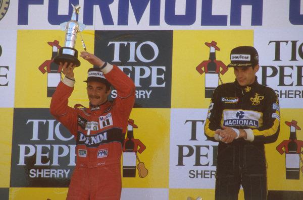 Jerez, Spain.11-13 April 1986.Ayrton Senna (Team Lotus) 1st position and Nigel Mansell (Williams Honda) 2nd position) on the podium.Ref-86 ESP 14.World Copyright - LAT Photographic
