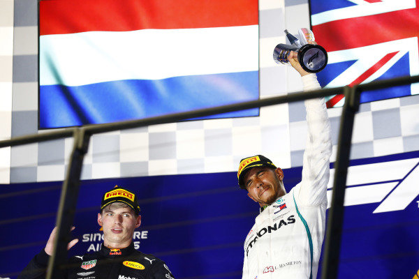 Max Verstappen, Red Bull Racing, and Lewis Hamilton, Mercedes AMG F1, celebrate on the podium