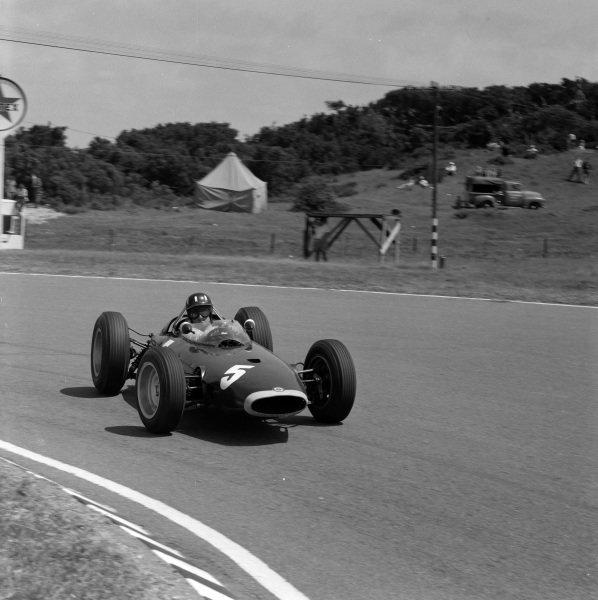 Graham Hill, BRM P57, gets sideways.