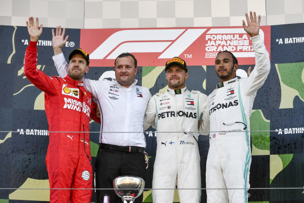 Sebastian Vettel, Ferrari, Race winner Valtteri Bottas, Mercedes AMG F1 and Lewis Hamilton, Mercedes AMG F1 celebrate on the podium