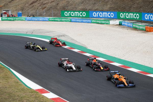 Lando Norris, McLaren MCL35, leads Max Verstappen, Red Bull Racing RB16, Kimi Raikkonen, Alfa Romeo Racing C39, Daniel Ricciardo, Renault R.S.20, and Charles Leclerc, Ferrari SF1000
