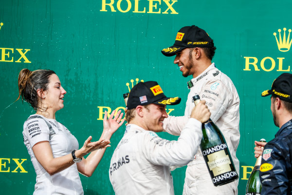Circuit of the Americas, Austin Texas, USA. Sunday 23 October 2016. Lewis Hamilton, Mercedes AMG, 1st Position, pours Champagne on Victoria Vowles, Partner Services Director, Mercedes AMG. World Copyright: Glenn Dunbar/LAT Photographic ref: Digital Image _31I5197
