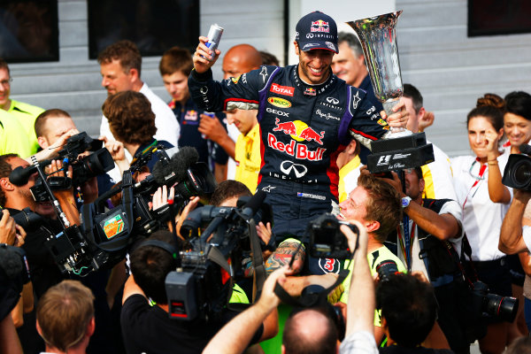 Hungaroring, Budapest, Hungary. Sunday 27 July 2014. Daniel Ricciardo, Red Bull Racing, 1st Position, and the Red Bull team celebrate victory. World Copyright: Andy Hone/LAT Photographic. ref: Digital Image _ONY2937