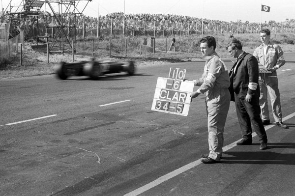 A pit board hung out for Graham Hill (GBR), BRM, by his race engineer Alan Challis (GBR), left. BRM Designer and Team Manager, Tony Rudd (GBR), is pictured centre.Dutch Grand Prix, Zandvoort, 24 July 1966.