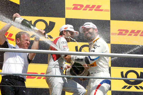 Podium: Stefan Reinhold, Team principal, BMW Team RMG, Timo Glock, BMW Team RMG.