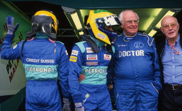 (L to R): Nick Heidfeld (GER) Sauber, Felipe Massa (BRA) Sauber and Sid Watkins (GBR) FIA Doctor. Formula One World Championship, Rd15, Italian Grand Prix, Monza, Italy, 15 September 2002.