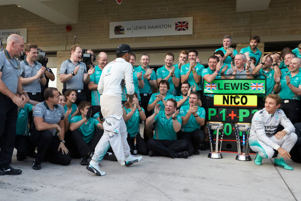 Circuit of the Americas, Austin, Texas, United States of America. Sunday 2 November 2014. Lewis Hamilton, Mercedes AMG celebrates with the team and Nico Rosberg, Mercedes AMG after winning the race. World Copyright: Steve Etherington/LAT Photographic. ref: Digital Image SNE10520