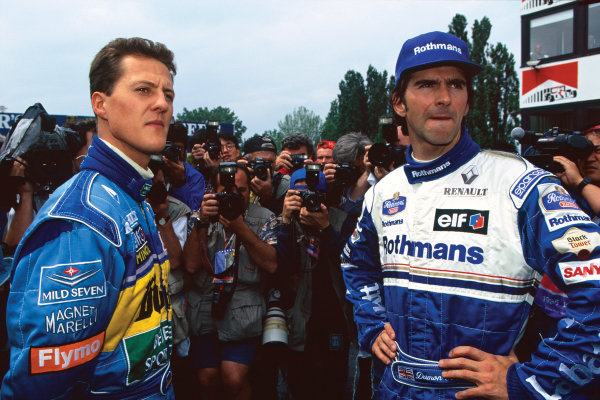 Imola, Italy. 28-30 April 1995. Michael Schumacher (Benetton B195 Renault), retired, with Damon Hill (Williams FW17-Renault), 1st position,  on the grid before the race, portrait.  World Copyright: LAT Photographic. Ref:  95 SM 08.