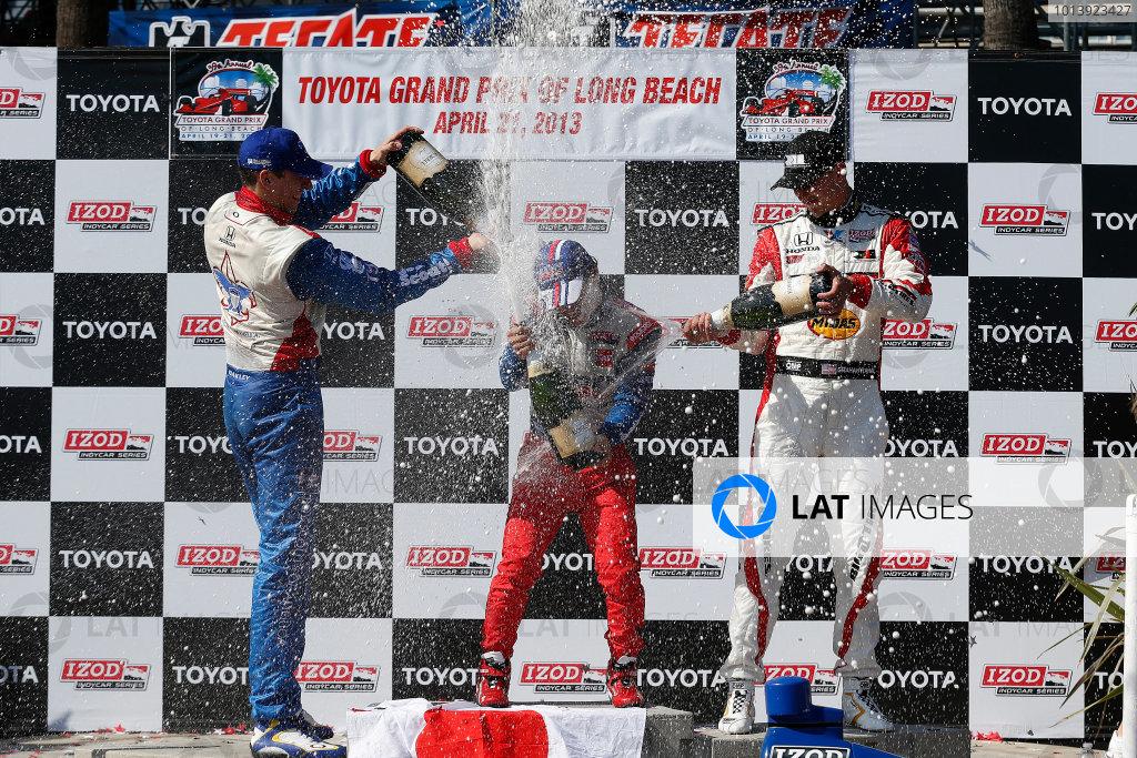 19-21 April, 2013, Long Beach, California, USA Justin Wilson, Takuma Sato and Graham Rahal on the podium with champagne © 2013, Michael L. Levitt LAT Photo USA