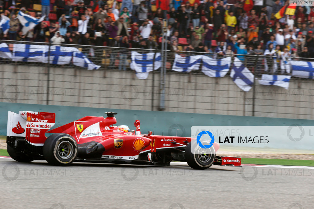 Shanghai International Circuit, Shanghai, China Sunday 14th April 2013 Fernando Alonso, Ferrari F138, 1st position, celebrates on his way to Parc Ferme. World Copyright: Charles Coates/LAT Photographic ref: Digital Image _N7T7459