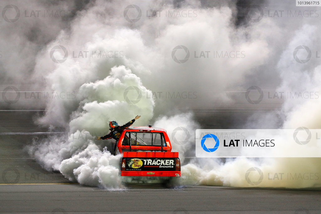 27 June, 2013, Sparta, Kentucky, USA Winner Ty Dillon does a burnout while hanging out of the truck © 2013, Michael L. Levitt LAT Photo USA