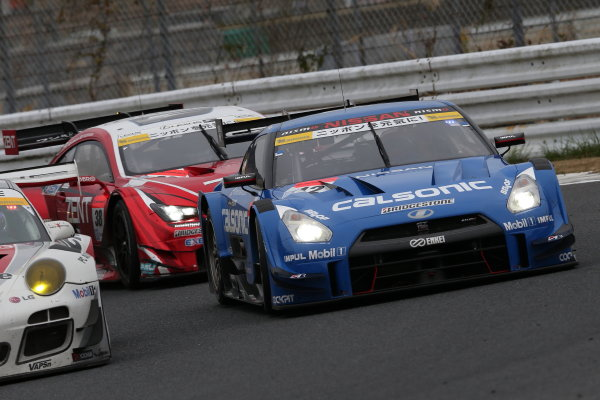 2015 Japanese Super GT Series. Autopolis, Japan. 31st September - 1st October 2015. Rd 7. GT500 2nd position Hironobu Yasuda & J.P.L.De Oliveira ( #12 CALSONIC IMPUL GT-R ) action World Copyright: Masahide Kamio/ LAT Photographic. Ref: 2015SGT_Rd7_05