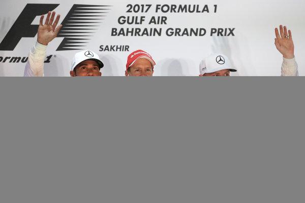 Bahrain International Circuit, Sakhir, Bahrain.  Sunday 16 April 2017. Lewis Hamilton, Mercedes AMG, 2nd Position, Sebastian Vettel, Ferrari, 1st Position, and Valtteri Bottas, Mercedes AMG, 3rd Position, on the podium. World Copyright: Steve Etherington/LAT Images ref: Digital Image SNE23058