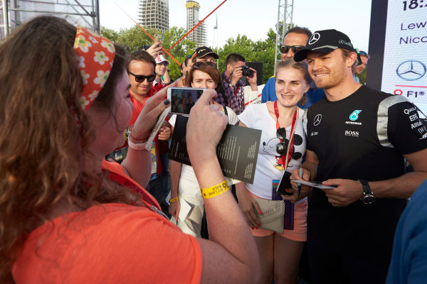 Baku City Circuit, Baku, Azerbaijan. Thursday 16 June 2016. Nico Rosberg, Mercedes AMG, poses for a photo with a fan. World Copyright: Steve Etherington/LAT Photographic ref: Digital Image SNE11875