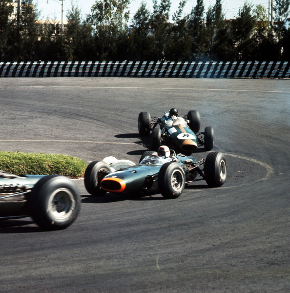 Mexico City, Mexico.22-24 October 1965.Jackie Stewart (BRM P261) leads Dan Gurney (Brabham BT11 Climax). Gurney finished in 2nd position.Ref-3/1877.World Copyright - LAT Photographic