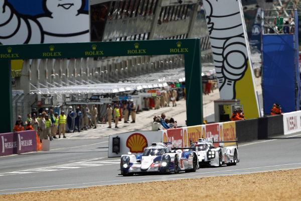 2014 Le Mans 24 Hours. Circuit de la Sarthe, Le Mans, France. Saturday 14 June 2014. Anthony Davidson (GBR), Nicolas Lapierre (FRA), Sebastien Buemi (CHE) - Toyota Racing, Toyota TS 040 - Hybrid, followed by Romain Dumas (FRA), Neel Jani (CHE), Marc Lieb (DEU) - Porsche Team, Porsche 919 - Hybrid  Photo: Sam Bloxham/LAT ref: Digital Image _G7C4695