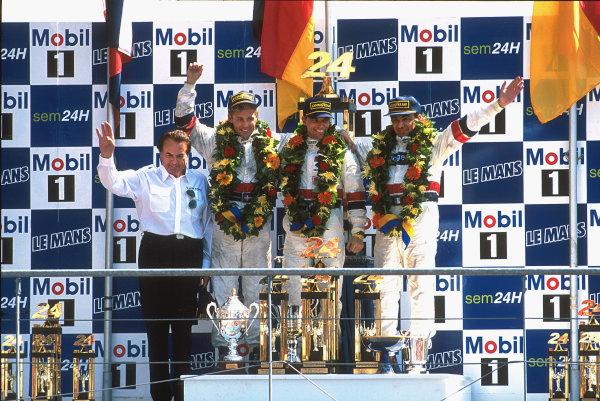 1997 Le Mans 24 Hours. Le Mans, France. 14th - 15th June 1997. Tom Kristensen/Stefan Johansson/Michele Alboreto (TWR Porsche WSC 95), 1st position, podium. World Copyright: LAT Photographic. Ref: 97LM02.