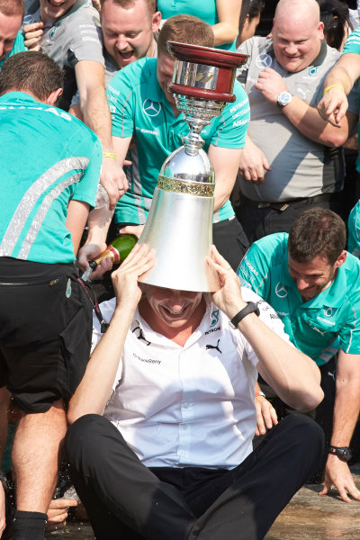 Autodromo Nazionale di Monza, Monza, Italy. Sunday 7 September 2014. Toto Wolff, Executive Director (Business), Mercedes AMG, uses a trophy as a hat. World Copyright: Steve Etherington/LAT Photographic. ref: Digital Image SNE15890