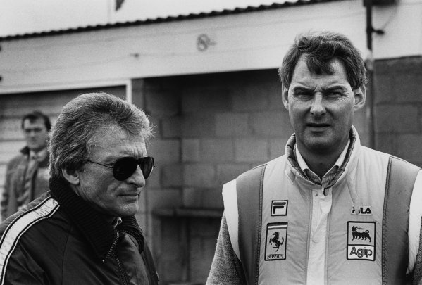 Silverstone, England. 19 - 21 July 1985.Gerard Ducarouge, Team Lotus, chats to Harvey Postlewaite, Ferrari, in the pits, portrait. World Copyright: LAT Photographic.Ref:  85 - 685 - 7.