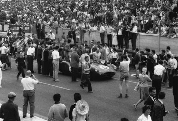 Le Mans, France. 20th - 21st June 1959 Roy Salvadori/Carroll Shelby (Aston Martin DBR1), 1st position, with Team Owner and Chief Designer, David Brown, sits on the car as they drive into parc ferme, action World Copyright: LAT PhotographicRef: 578 - 34A-35